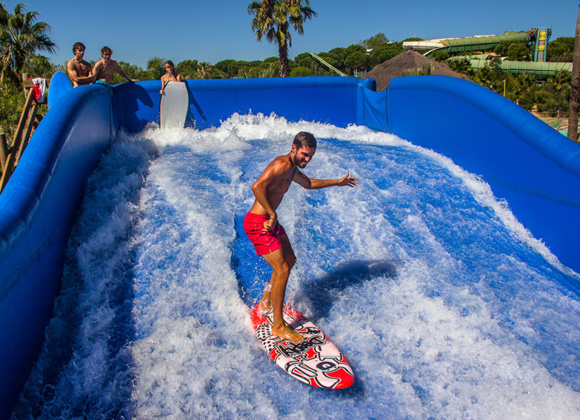 Man surfing on blue plastic feature