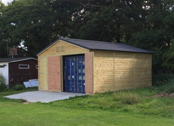 Wooden hut with blue container inside