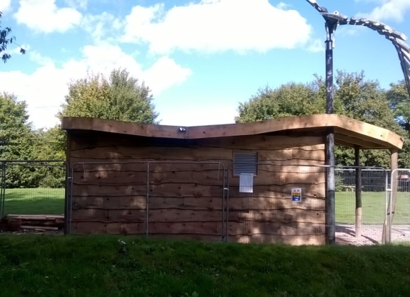 Wooden hut with metal air vent