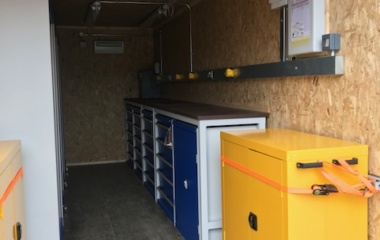 Shipping container interior with cabinets