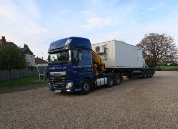Richard Tinsley lorry transporting white container
