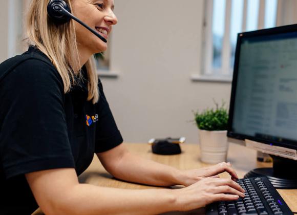 Female Staff Member Wearing Headset