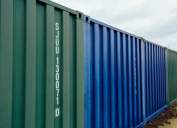Blue and green Shipping Containers