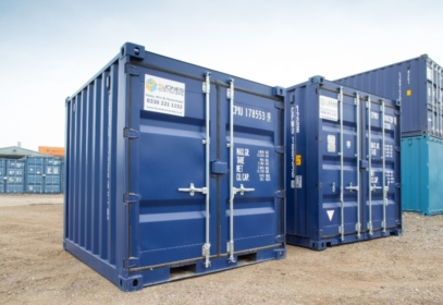 Two 10ft blue containers surrounded by others