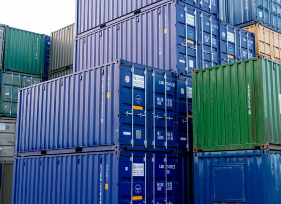 Stacked shipping containers in blue and green