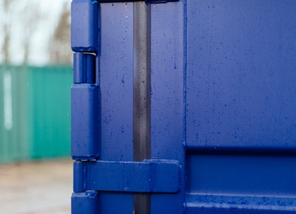 Blue container close up in rain