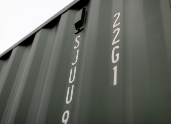 Close up low view of dark green container