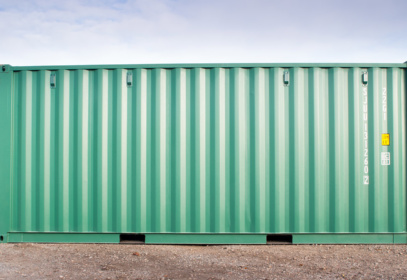 Side view of a green 40ft shipping container