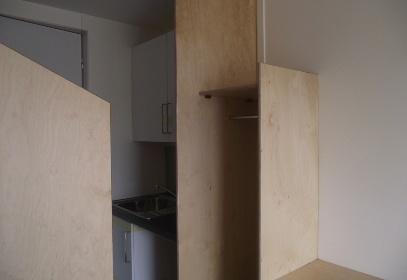 Wooden boards inside container kitchen