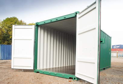 Green container with white interior and doors open