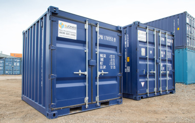 Two Blue 10ft Shipping Containers With Closed Doors