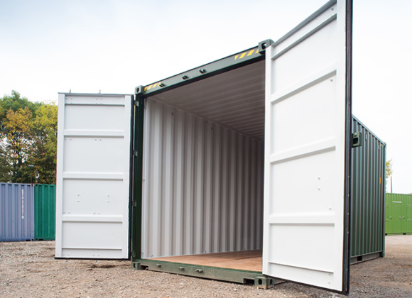 Green container with doors open