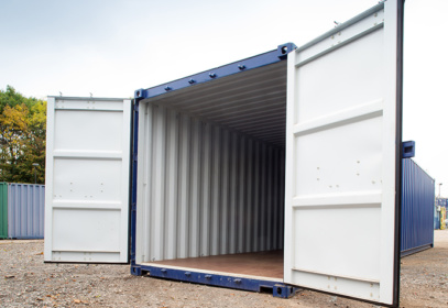 White doors open on blue container