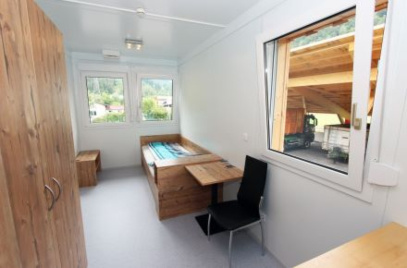 Bedroom with desk and wooden furniture