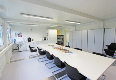 Meeting room with wardrobes and strip lights