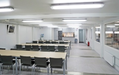 Classroom with rows of tables and chairs