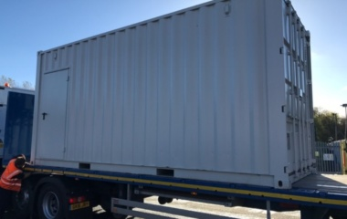 Container being loaded onto lorry