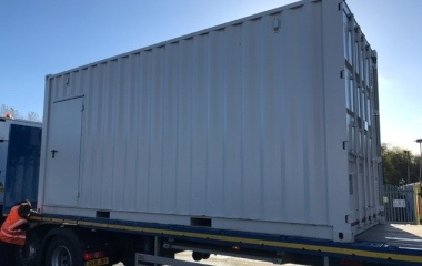 Grey Container on Lorry