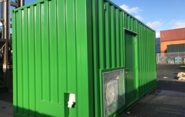 Green container with air vent in sun
