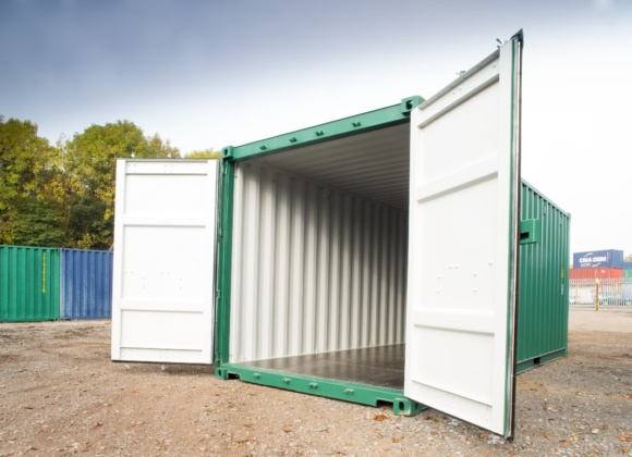 Green container white doors open