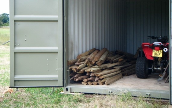 Quad bike and logs inside container