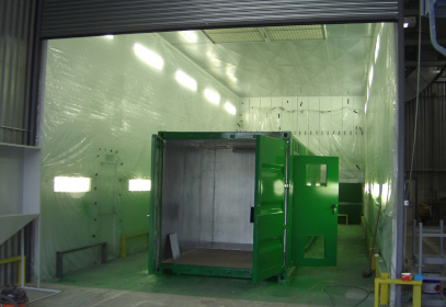 Green container in paint shop