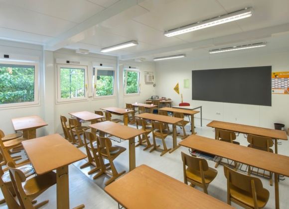 Classroom with blackboard and wooden furniture