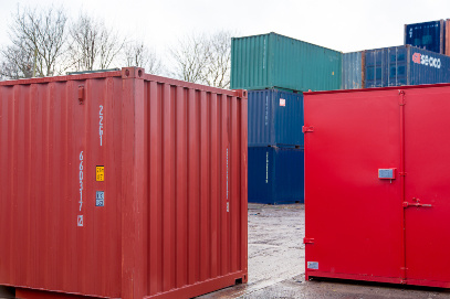 Red containers with blue container in background