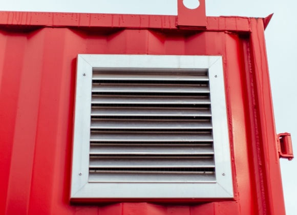 Silver air vent on red container