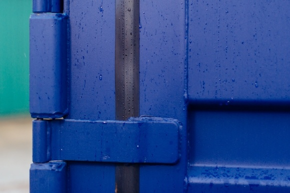 Blue corner of container in rain