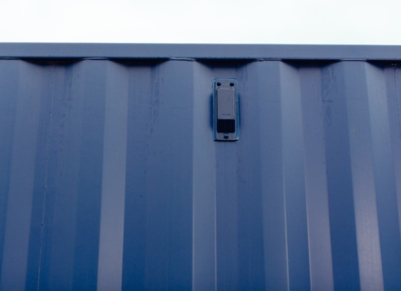 Blue switch on the side of container