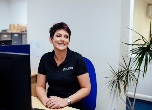 Sarah Green smiling at desk