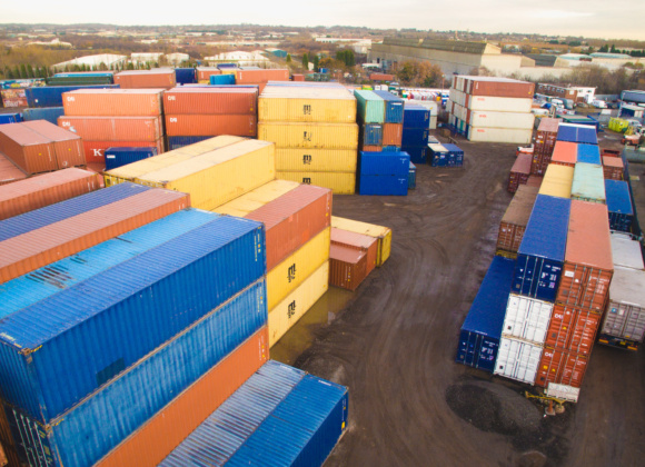 Multicoloured containers in yard