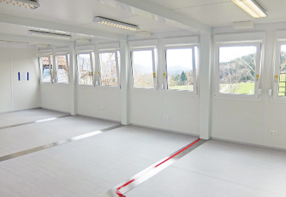 White interior of container with 8 windows