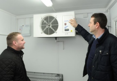 Colleagues discussing fan