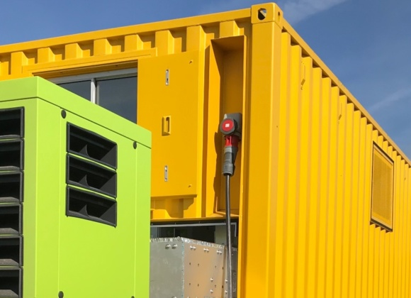 Neon yellow and green Pramac containers