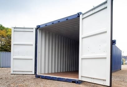 White doors open on blue container gallery L